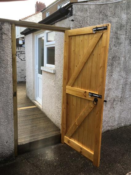Timber gate with black powder coated ironmongery